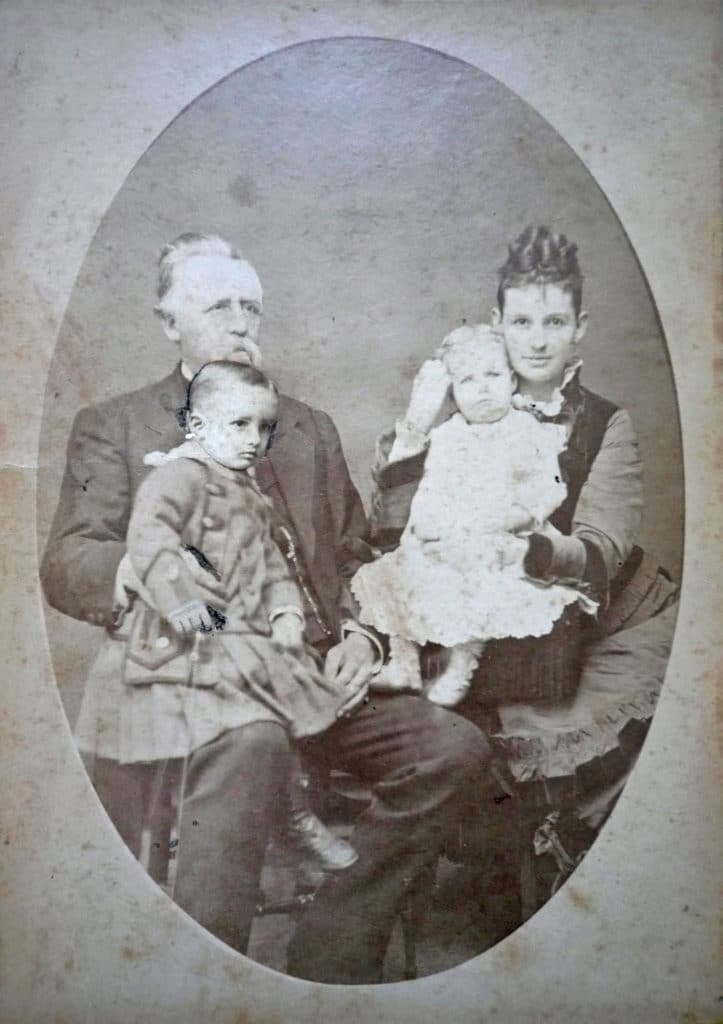 Colonel Leonard, his wife Isabella, and children Bill And Mary. Note that Bill squirmed and his head was cut out and replaced
